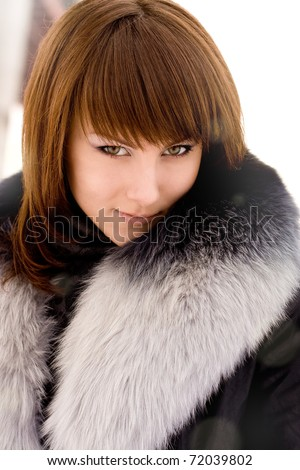 young beautiful girl in a fur collar