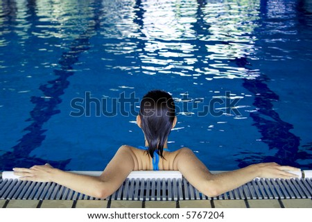 Young beautiful girl in a swimming pool