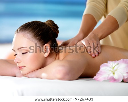 Young beautiful girl in beauty salon getting spa massage