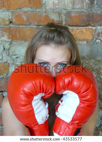 young beautiful girl in red boxing gloves
