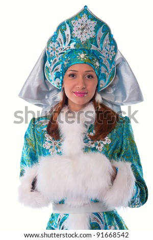 Young beautiful girl in the costume of Snow Maiden looks straight