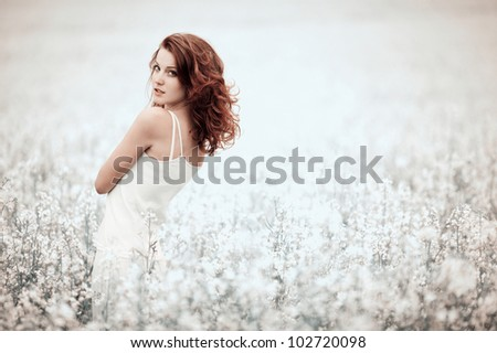 young beautiful girl in the field - stock photo