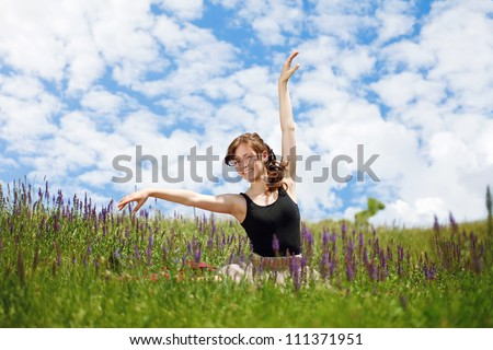 Young beautiful girl in the in lavender field