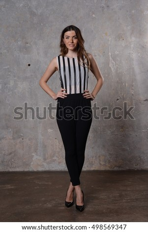 Young beautiful girl in the summer clothes #498569347