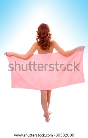 Young beautiful girl in towel after shower on white background