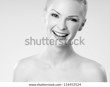 young beautiful girl laughs - stock photo