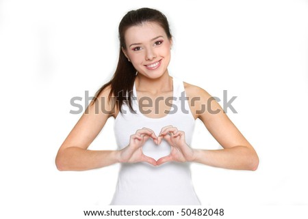 young beautiful girl showing heart symbol over white