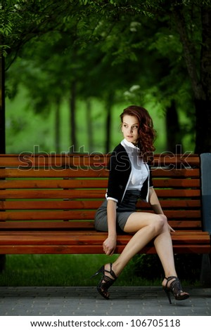 young beautiful girl sitting on bench