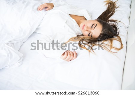 Young beautiful girl sleeps in bed at home
