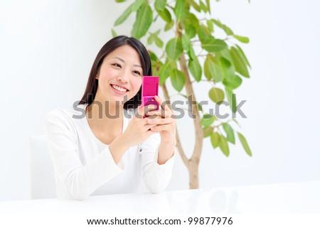 Young beautiful girl using mobile phone