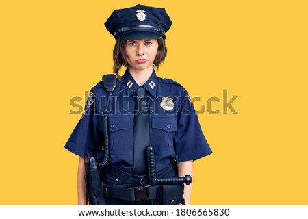 Young beautiful girl wearing police uniform skeptic and nervous, frowning upset because of problem. negative person.  Сток-фото ©