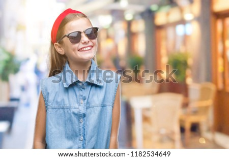 Young beautiful girl wearing sunglasses over isolated background with a happy and cool smile on face. Lucky person. #1182534649