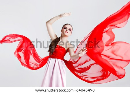 young beautiful girl with a red fabric