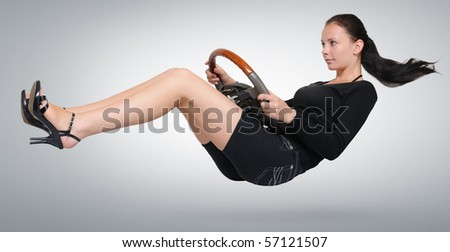 Young beautiful girl with a wheel