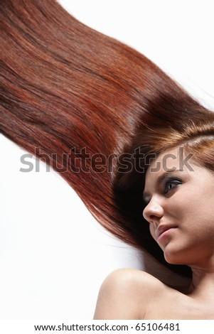 Young beautiful girl with shiny healthy hair