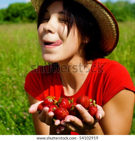 young beautiful girl with strawberry