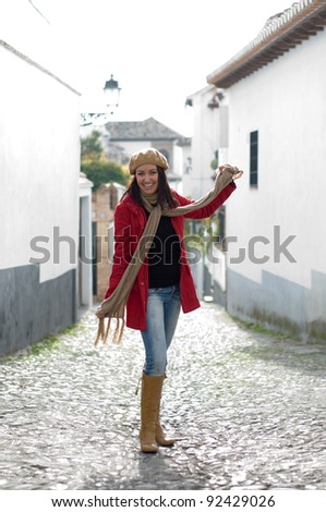 Young beautiful girl with winter clothes in the street