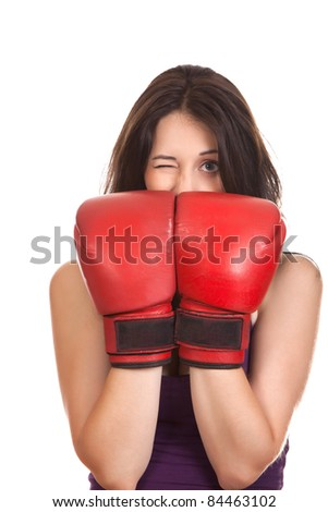 Young beautiful happy boxer woman with red boxing gloves cover face isolated on white, series photo