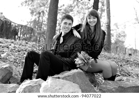 Young beautiful happy couple in love against the background of nature. Black and white