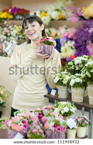 Young beautiful happy smiling female lady woman working in flower shop & presenting flowers
