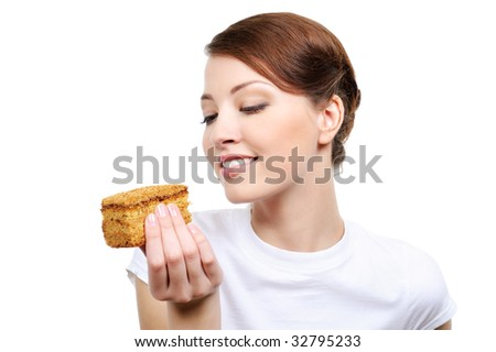 young beautiful happy woman eating cake - isolated