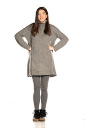 Young beautiful happy woman in gray tunic on white background