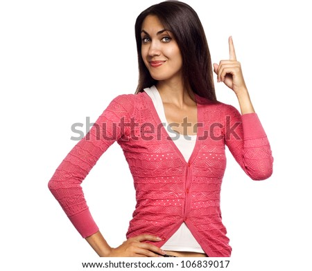 Young beautiful happy woman pointing up