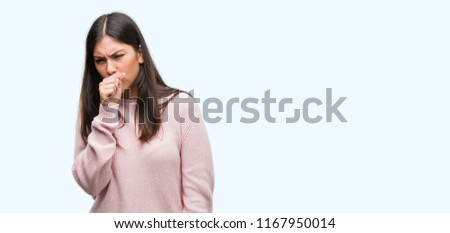 Young beautiful hispanic woman wearing a sweater feeling unwell and coughing as symptom for cold or bronchitis. Healthcare concept.