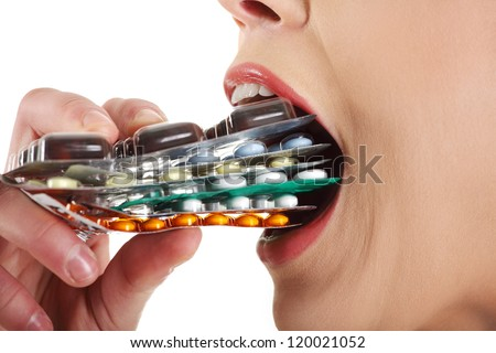 Young beautiful ill woman with pills. Isolated on white background.