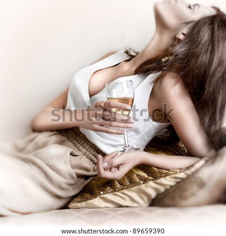 Young beautiful lady drinking champagne.