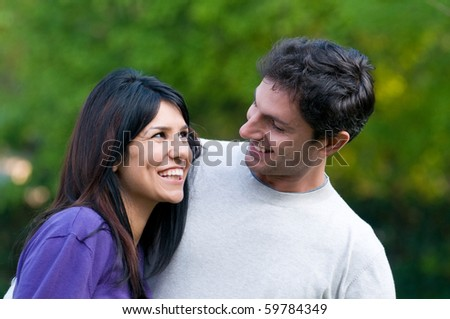 Young beautiful latin couple have fun together outdoor in the nature