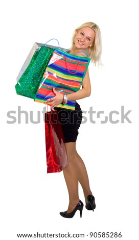 Young beautiful laughing woman with purchases from shop