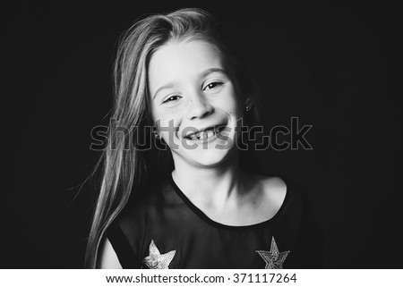 Young beautiful little girl smiles #371117264