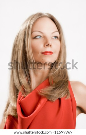 Young beautiful model in red with hair and make-up professionally done.
