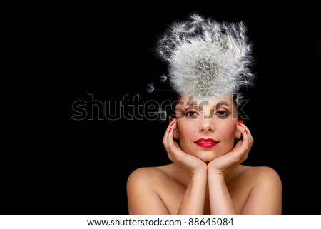 Young, beautiful model posing with an unique hat (dandelion)