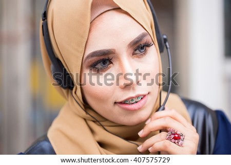 Young beautiful  Muslim woman working in a call-center