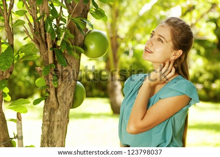 Young beautiful natural woman in the garden - stock photo