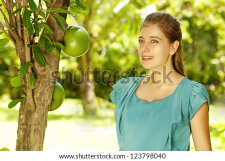 Young beautiful natural woman in the garden