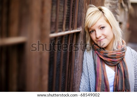 Young beautiful  portrait of a blond girl. Focus on the right eye.
