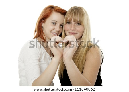 young beautiful red and blond haired girls form a heart in front of white background