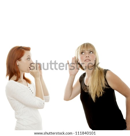 young beautiful red and blond haired girls shout and hear in front of white background