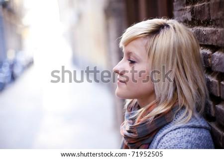 Young beautiful sad girl close portrait