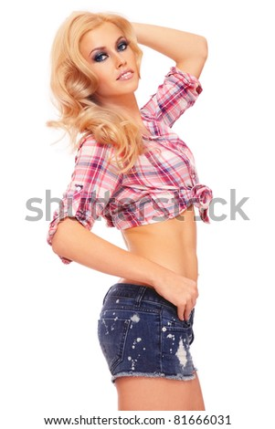 Young beautiful sexy blond girl in casual outfit on white background
