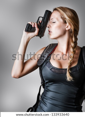 Stock Photo Young beautiful sexy blond Woman holding Handgun in hand