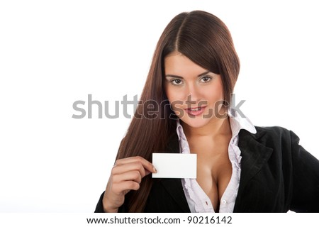 Young beautiful sexy brunette girl standing and holding a business card, isolated over white