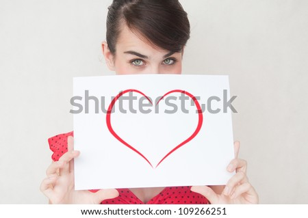 Young beautiful sexy woman showing gift card. Valentine's Day