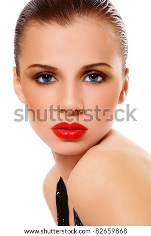 Young beautiful sexy woman with glamorous make-up and red lips on white background