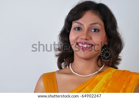 Young beautiful smiling Indian woman for advertising.