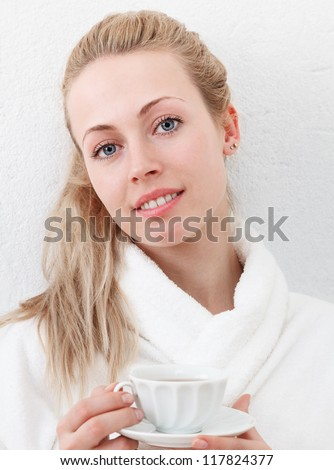 Young beautiful smiling woman with tea cup