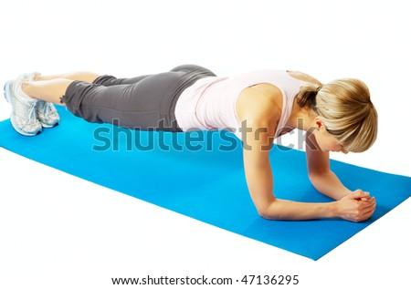 Young beautiful sportswoman practicing yoga on a mat.